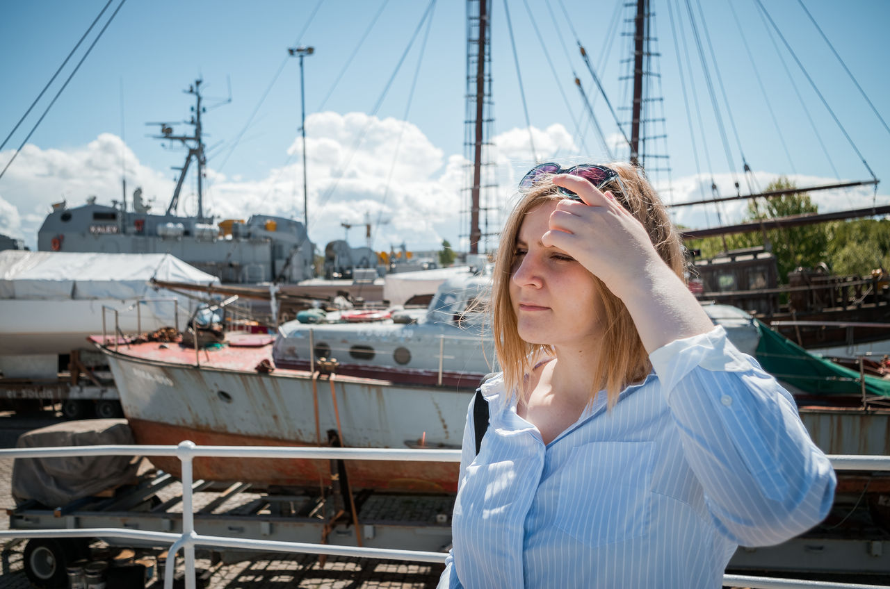 Young Woman Standing Against Railing On Ship
