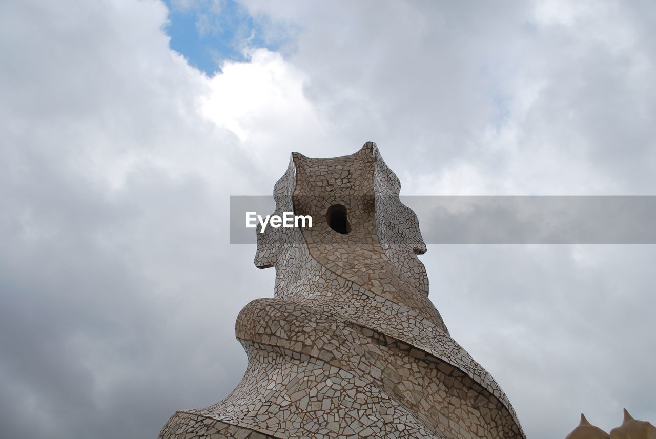 cloud - sky, low angle view, sky, history, day, sculpture, statue, no people, ancient, outdoors, travel destinations, built structure, architecture, ancient civilization, nature