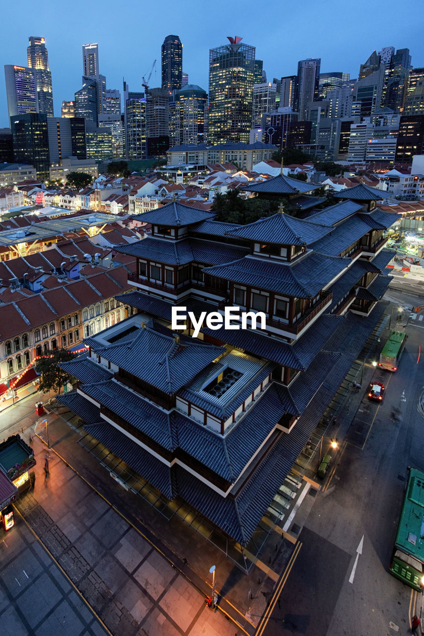 building exterior, city, architecture, built structure, high angle view, cityscape, building, illuminated, dusk, city life, no people, residential district, night, modern, office building exterior, nature, outdoors, street, tall - high, sky, skyscraper, financial district