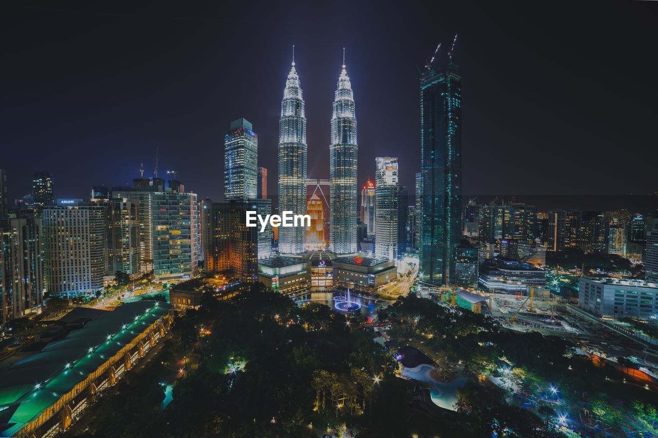 architecture, built structure, building exterior, city, night, cityscape, illuminated, sky, skyscraper, tall - high, building, office building exterior, modern, tower, urban skyline, no people, travel destinations, residential district, landscape, outdoors, financial district, spire