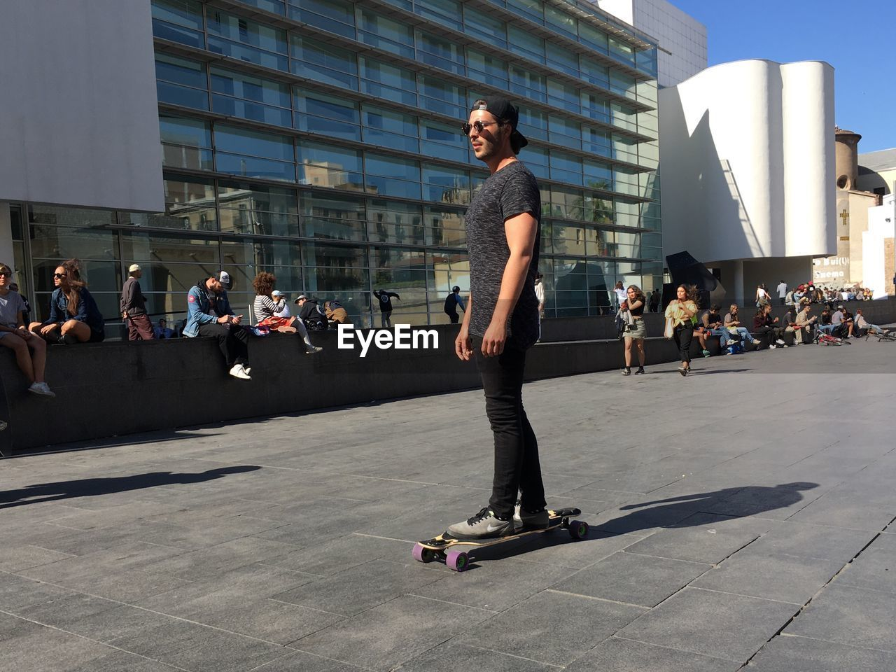 skateboard, skill, building exterior, built structure, lifestyles, real people, leisure activity, day, architecture, balance, outdoors, sunlight, full length, city, skateboard park, stunt, sport, men, people