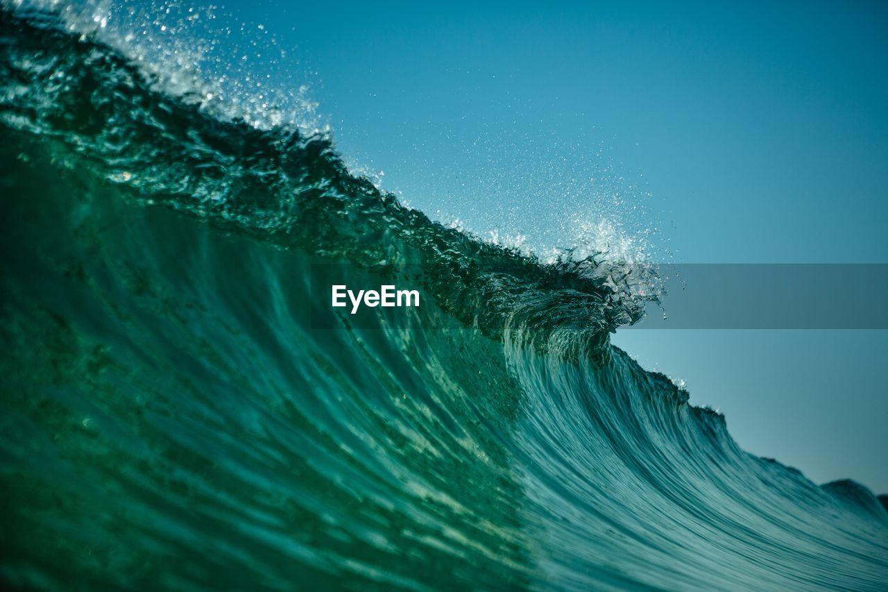 CLOSE-UP OF BLUE SEA AGAINST SKY