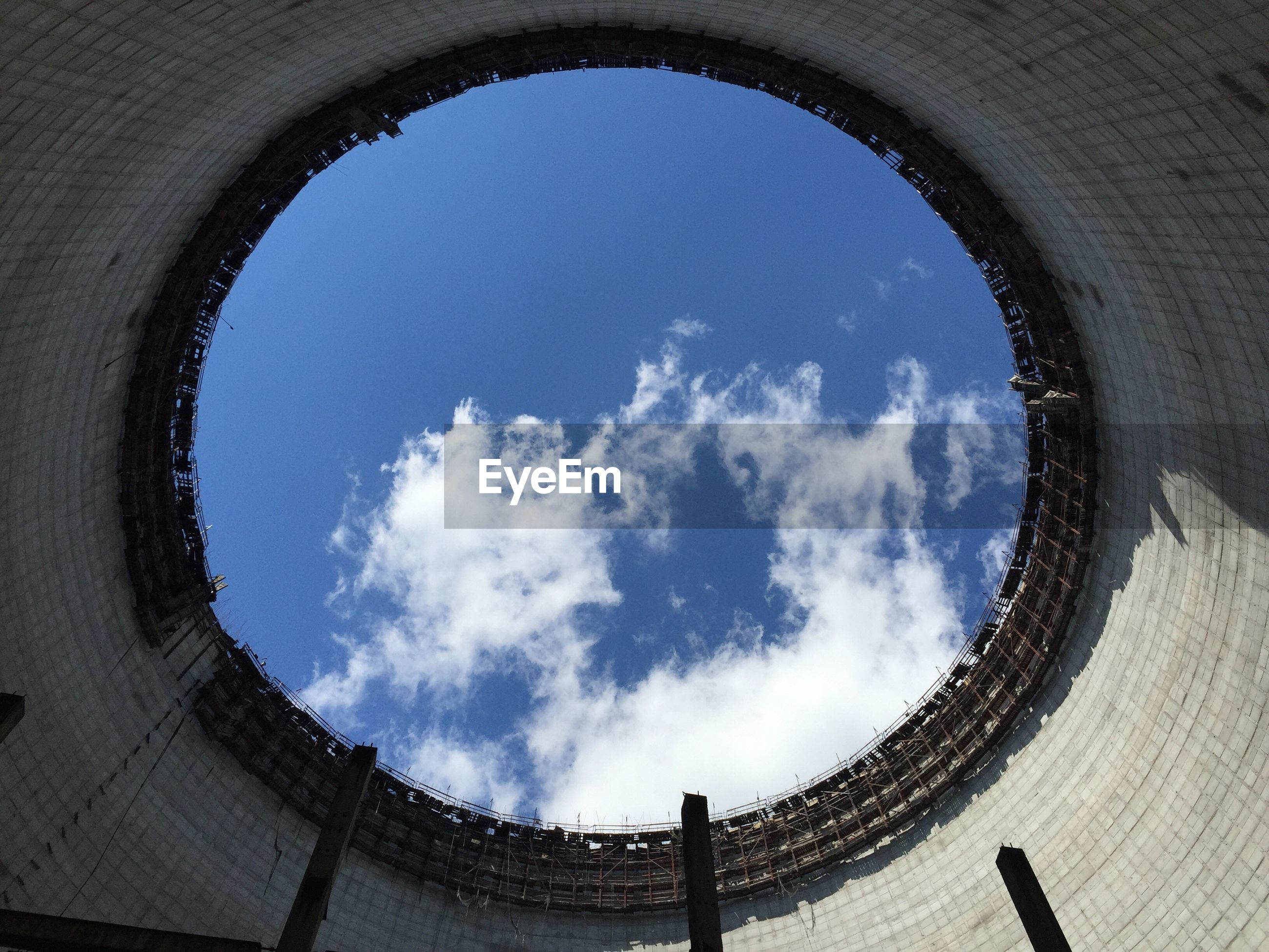 Low angle view of sky seen through cooling tower