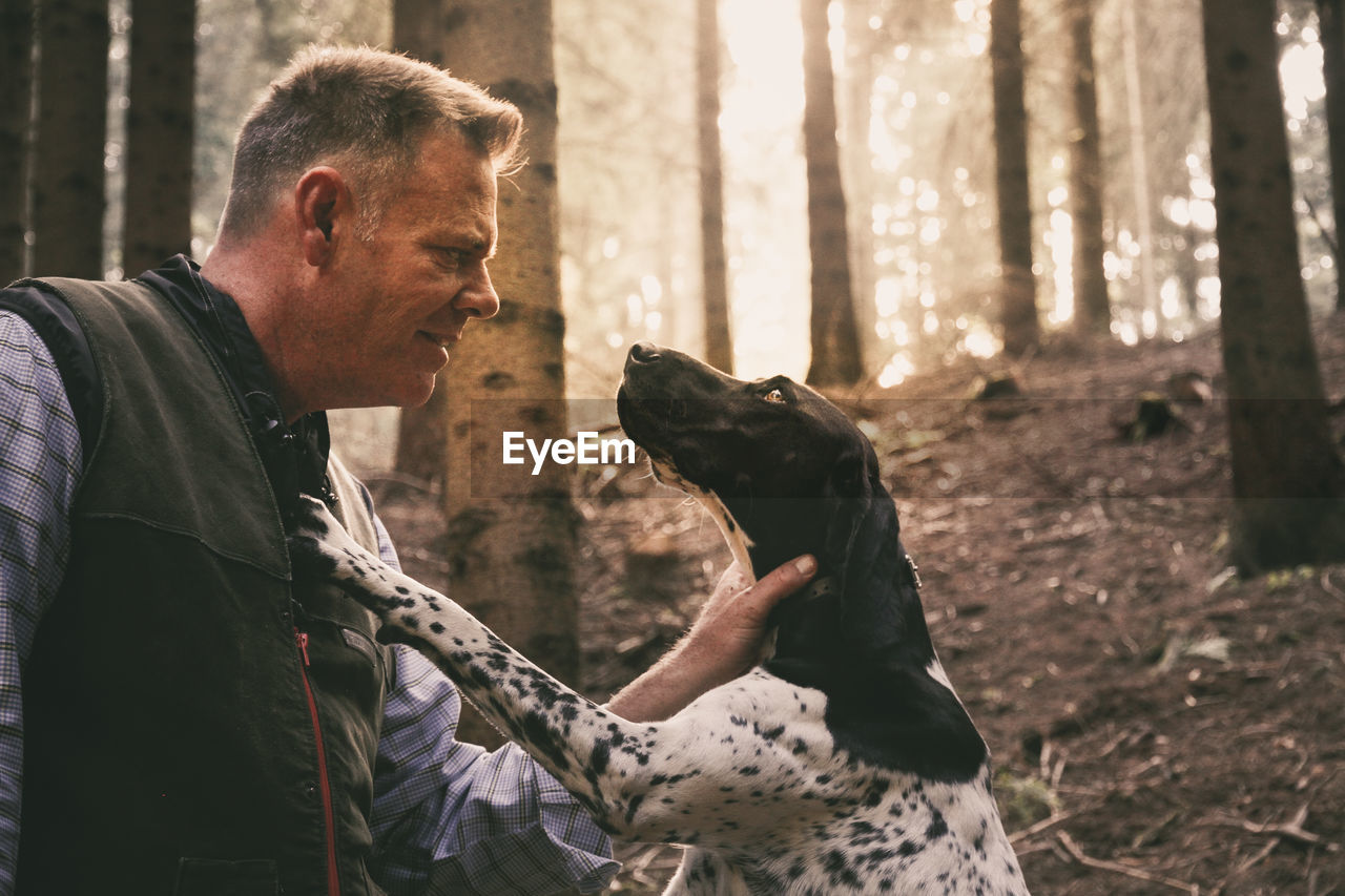 Man And Dog In Forest