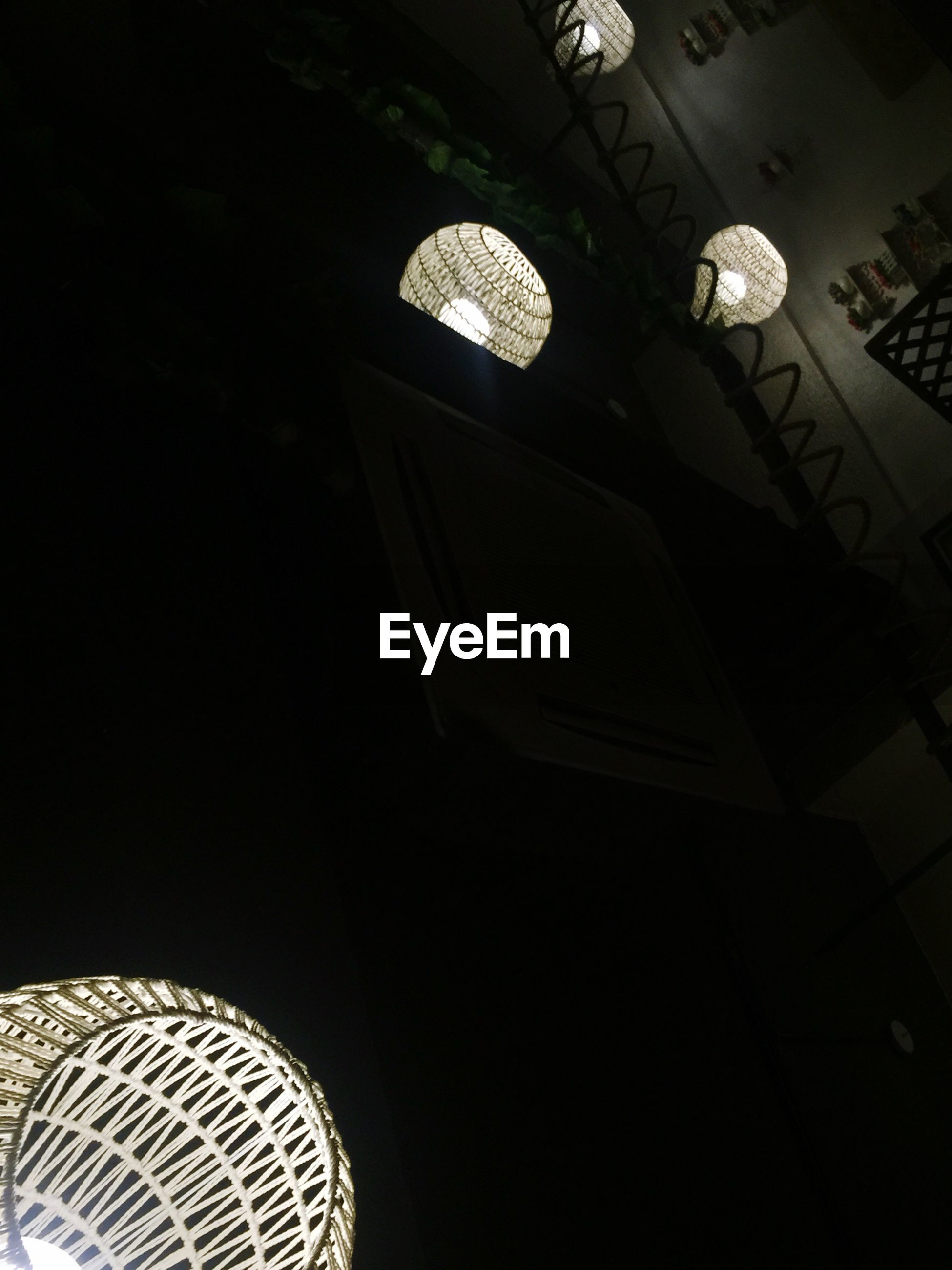 low angle view, night, illuminated, circle, architecture, built structure, lighting equipment, modern, indoors, pattern, copy space, dark, arts culture and entertainment, no people, clear sky, building exterior, geometric shape, design, shape, electric lamp