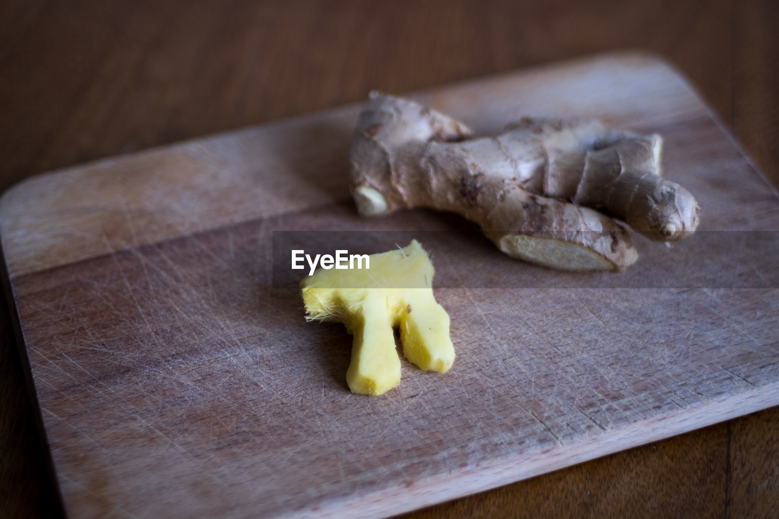 High angle view of ginger on cutting board