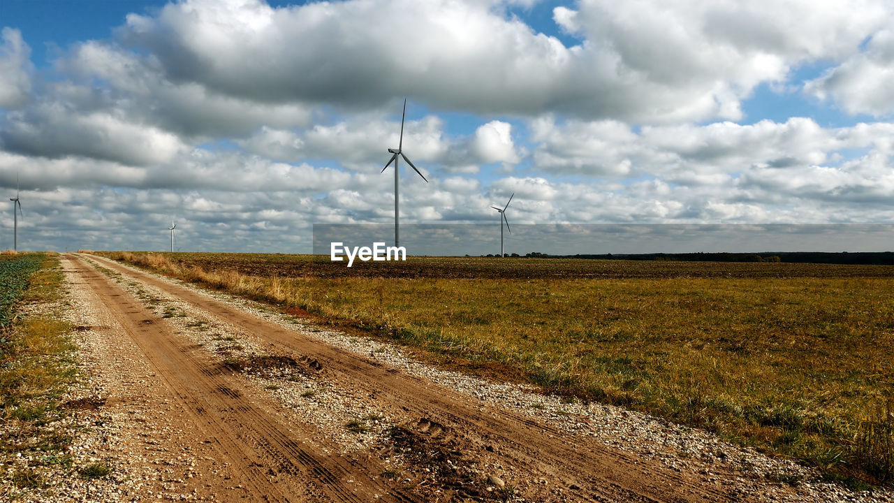 environment, fuel and power generation, landscape, cloud - sky, sky, wind turbine, environmental conservation, field, turbine, land, alternative energy, renewable energy, wind power, nature, no people, rural scene, transportation, direction, day, technology, outdoors, power in nature