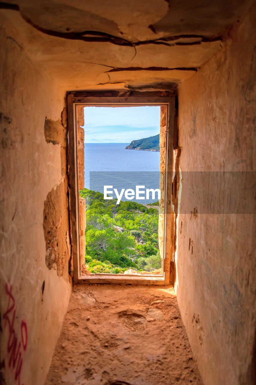 window, land, indoors, nature, scenics - nature, water, sea, sky, travel, architecture, no people, day, beach, horizon, tranquility, beauty in nature, landscape, travel destinations, horizon over water