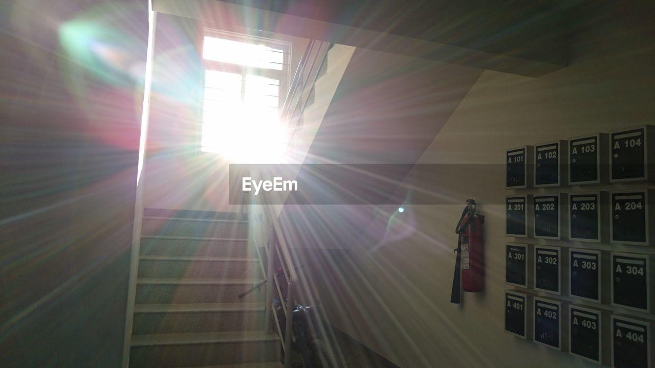 lens flare, sun, sunbeam, sunlight, window, architecture, light beam, day, no people, indoors, building exterior, nature, sky