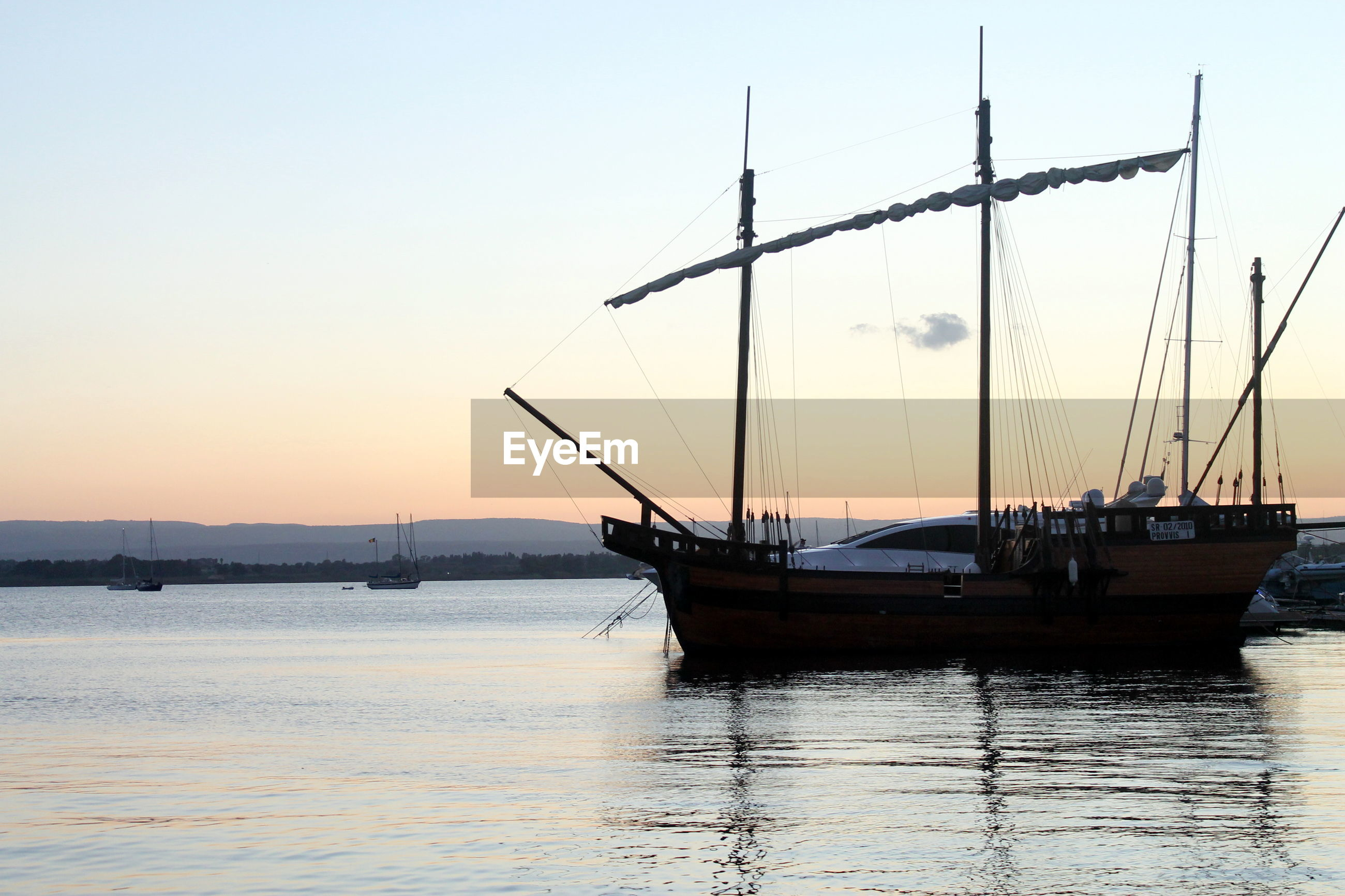 SILHOUETTE OF NAUTICAL VESSEL ON SEA AGAINST CLEAR SKY