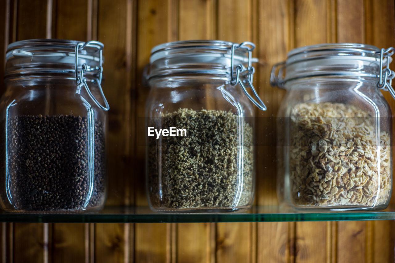 Close-up of glass jars on shelf
