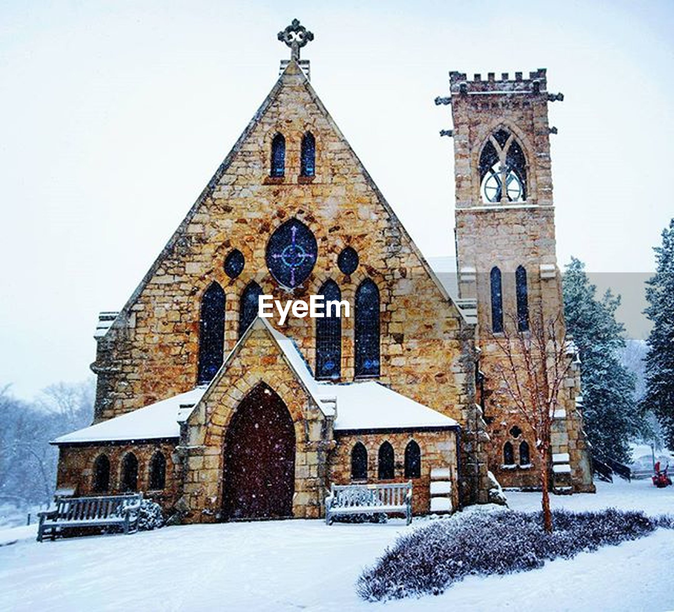 religion, building exterior, architecture, church, built structure, place of worship, spirituality, snow, winter, cross, cold temperature, season, facade, low angle view, clear sky, cathedral, sky, outdoors