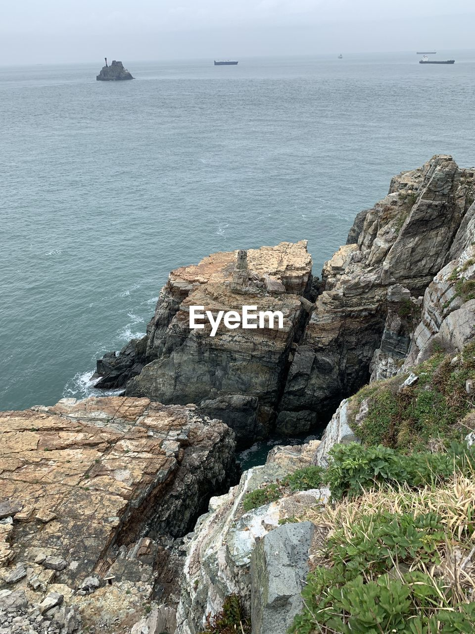 sea, rock, beauty in nature, rock - object, solid, scenics - nature, water, day, rock formation, sky, tranquil scene, nature, horizon over water, tranquility, horizon, no people, cliff, land, outdoors, rocky coastline, formation