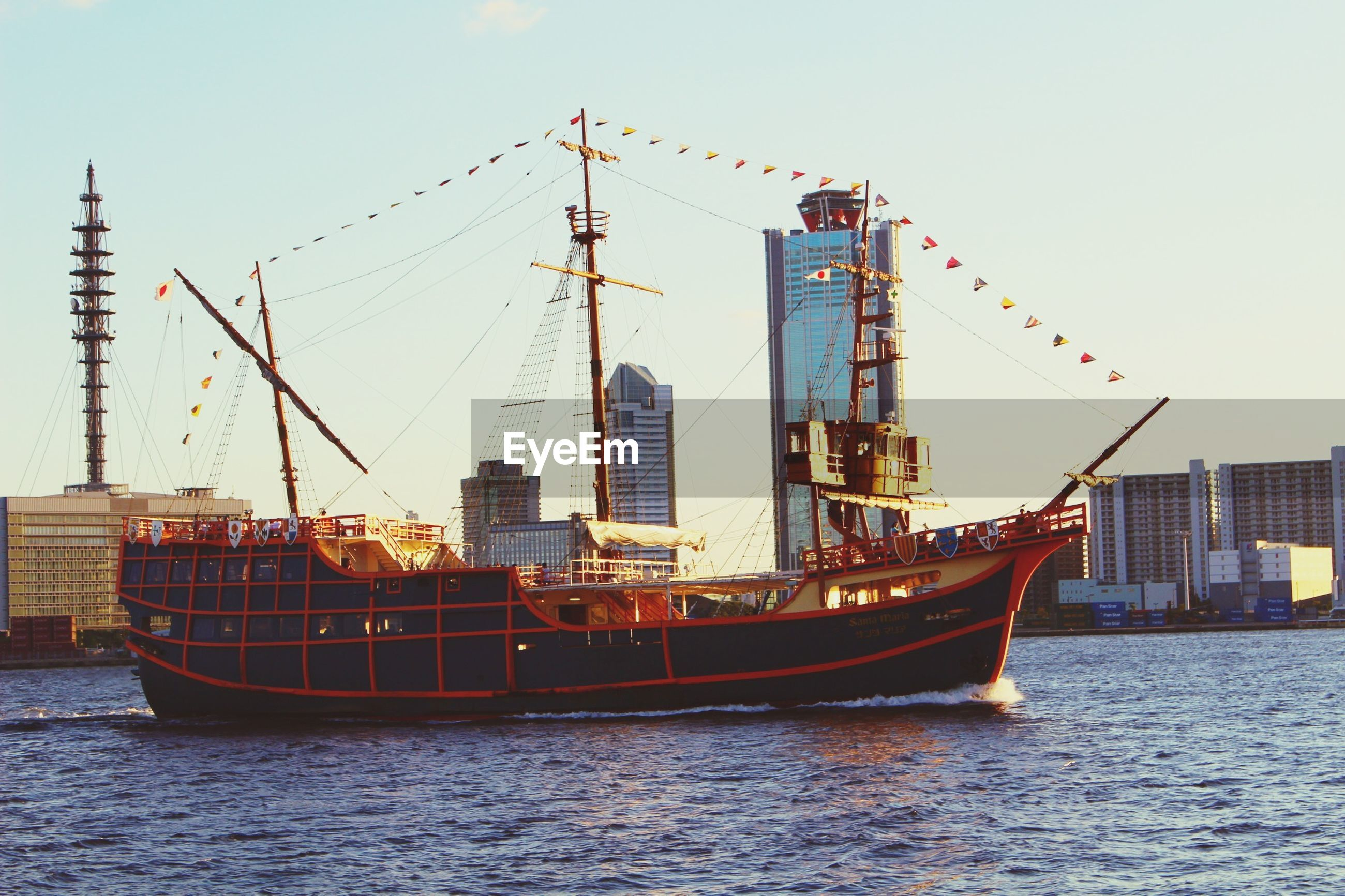 nautical vessel, water, waterfront, building exterior, transportation, boat, architecture, built structure, mode of transport, crane - construction machinery, harbor, sea, city, clear sky, moored, mast, commercial dock, ship, sky, river