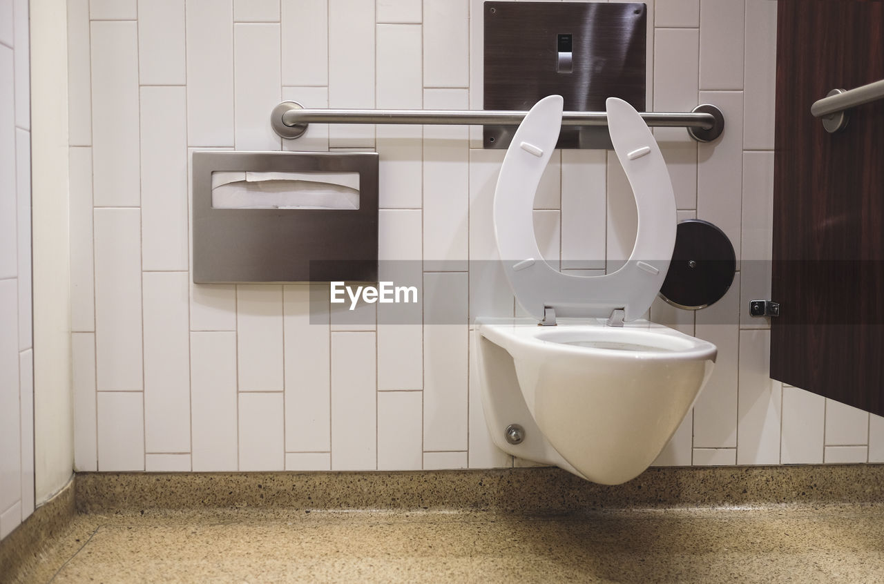 Commode Against Tiled Wall