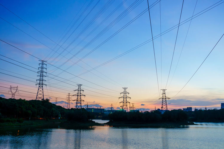 Scenic view of electricity pylon against sky during sunset