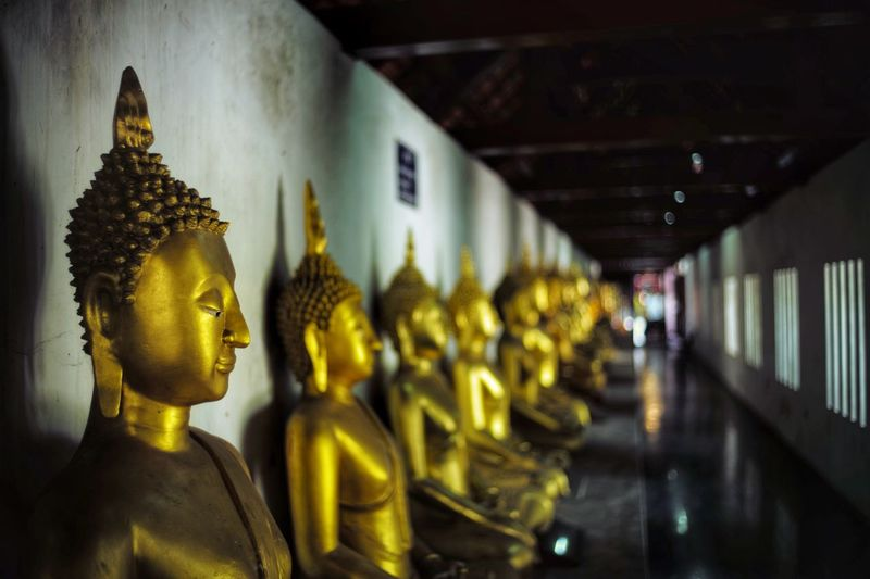Buddha Wat Temple Thailand Leica M (Type 240) Buddha Human Representation Representation Male Likeness Art And Craft Statue Indoors  Religion No People Focus On Foreground Gold Colored Close-up In A Row Architecture