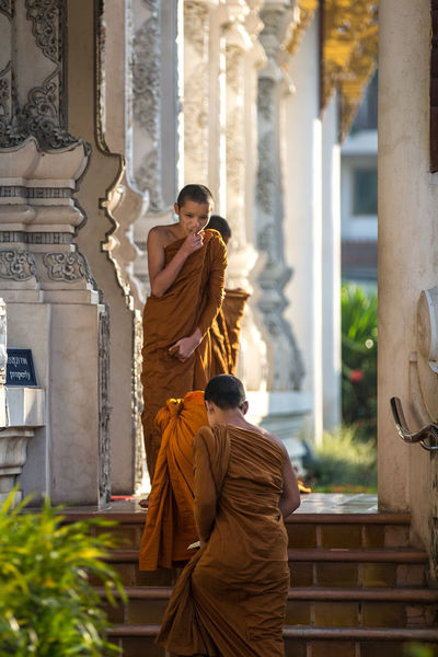 Young buddhist monks right before morning prayers Apprentice Buddhist Buddhist Monks Chiang Mai Monk  Orange Robes Religion Robe Spotted In Thailand Temple Thailand Traditional Culture Worship Young Up Close Street Photography The Street Photographer - 2016 EyeEm Awards