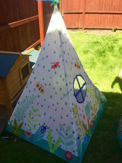 Wigwam Playtent Tent Close-up Multi Colored Sunlight Leisure Activity Shape Outdoors Celebration Pattern High Angle View Nature Architecture Day Decoration Holiday Grass Plant Design No People