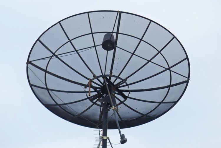 Close up of Satellite Dish on Clear Sky Background Background Clear Sky Close-up Communication Connection Day Global Communications Low Angle View No People Outdoors Radio Wave Satellite Dish Sphere Technology