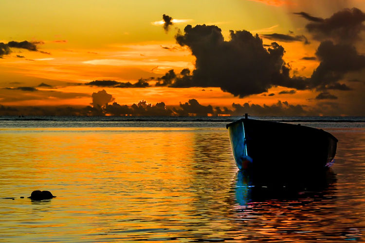 Water Sunset Sky Orange Color Cloud - Sky Beauty In Nature Sea Scenics - Nature Waterfront Nature Tranquil Scene Silhouette Reflection Tranquility No People Idyllic Mode Of Transportation Transportation Outdoors Boat Mauritius Indian Ocean