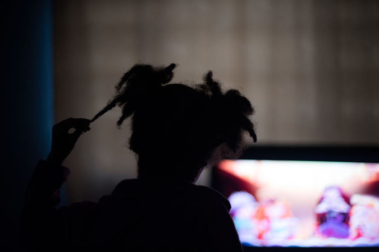 Silhouette Of Girl Watching Television