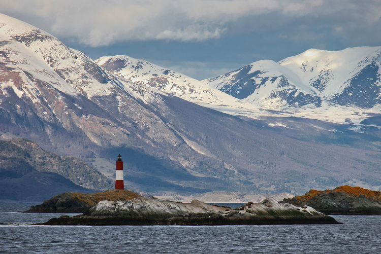 Scenic View Of Snowcapped Mountains By Sea Against Sky
