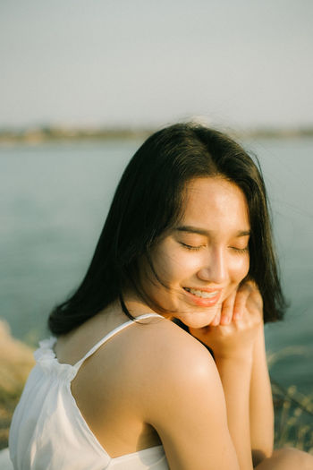 Portrait of a beautiful young woman with eyes closed