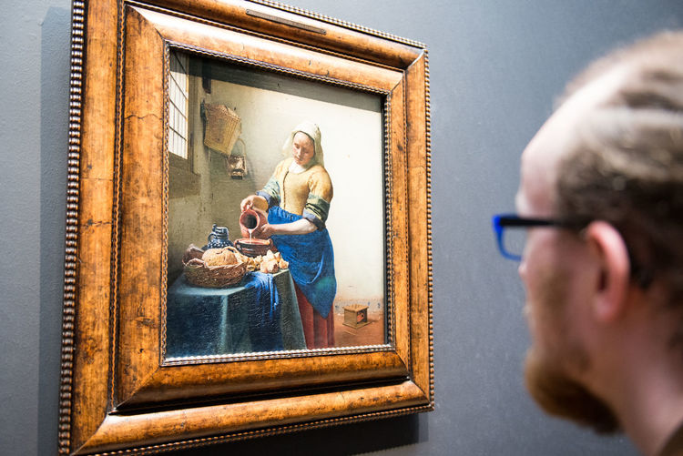 Portrait of man with reflection in mirror