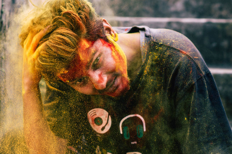 Portrait of young man covered with powder paint