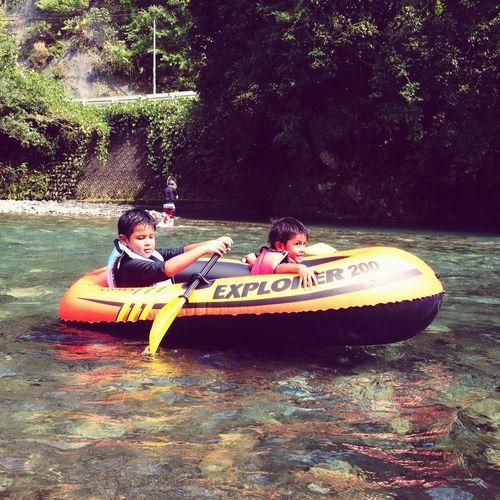 At The River Boats Boating En El Río  Kids Having Fun