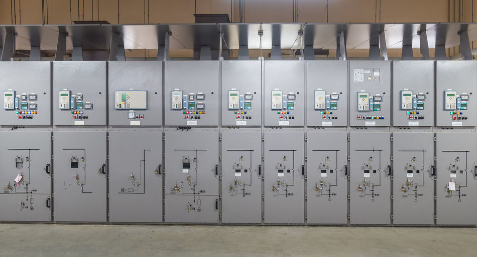 Indoors  Control Technology No People In A Row Fuel And Power Generation Side By Side Electricity  Industry Large Group Of Objects Equipment Architecture Communication Control Panel Control Room Number Gray Connection Meter - Instrument Of Measurement Wall - Building Feature Power Supply Switchgear
