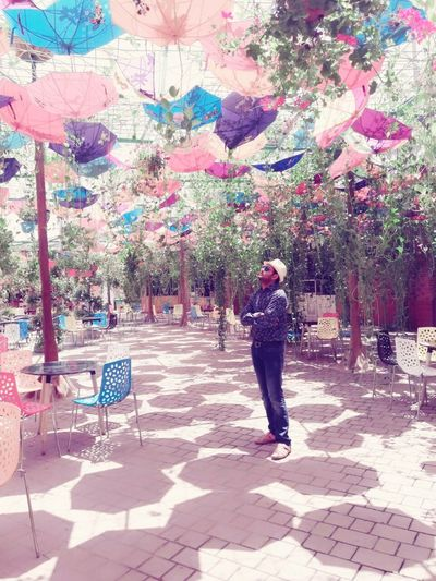One Person Young Adult Outdoors City Tree Only Men Adult Day Sunglasses Handsome Beautiful People Macho Lifestyles Travel Destinations Standing Cloud - Sky Hat Umbrella☂☂ Garden Flowers Garden Colour Of Life Colorful Umbrellas In The Sky Dubai Dubaicity