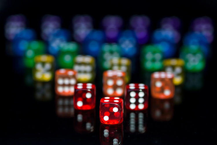 Close-up of multi colored dices on black background