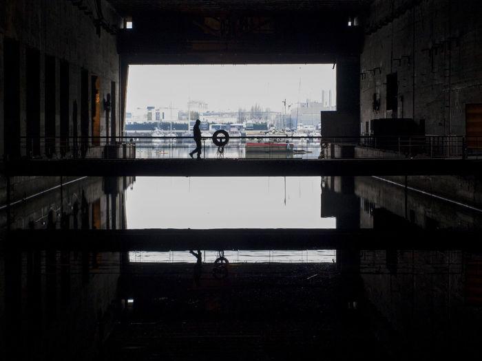 Silhouette of man walking indoors