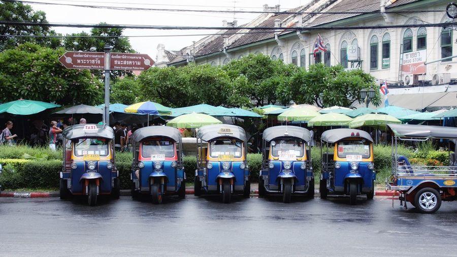 Jinrikishas parked on street