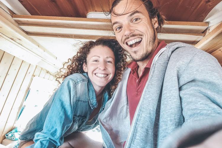 Portrait of smiling couple in mini van