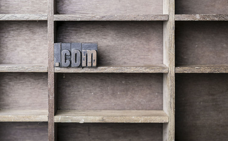 old wooden printers type forming the .com Antique Business Printing Typography Wood Close-up Concept Conceptual Letter No People Printing Letters Texture Vintage Wood - Material