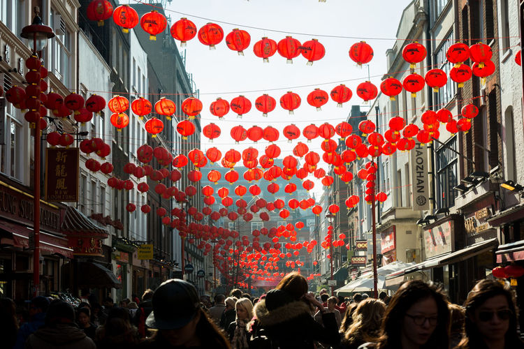 Lanterns hanging over people in city