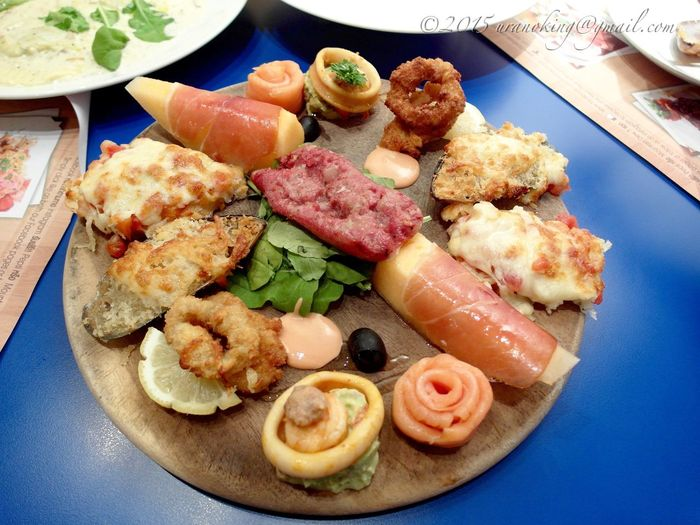 High angle view of seafood appetizers served in plate on table