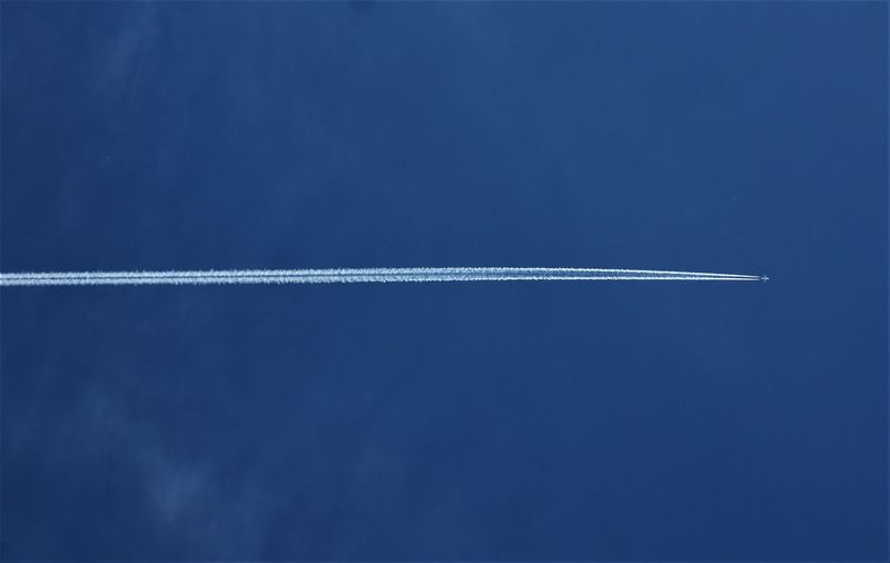 Vapor trail against blue sky