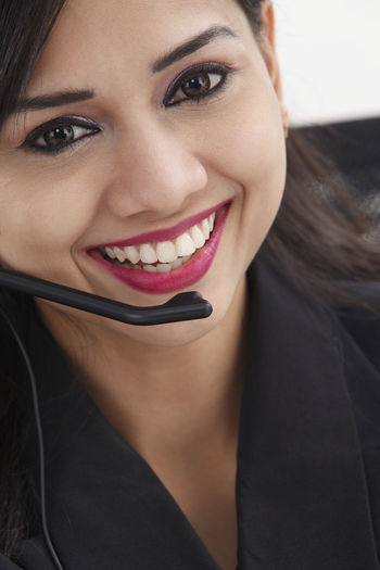 Asian Ethnicity Indian Ethnicity Beautiful Woman Talking Reception Call Center Assistant Attractive Black Hair Business Businesswoman Corporate Business Headset Formalwear Uniform Consultant Help Helpdesk Career Using Phone Communication Connection Telemarketing Occupation Receptionist Portrait Smiling Headshot Happiness Make-up Front View