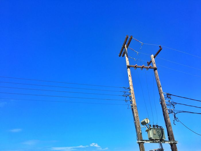 Architecture Blue Cable Clear Sky Communication Connection Copy Space Day Electricity  Electricity Pylon Fuel And Power Generation Low Angle View Nature No People Occupation Old Outdoors Power Line  Power Supply Sky Technology Telephone Line