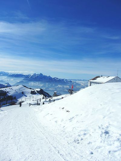 EyeEm Selects Snow Winter Cold Temperature Mountain Weather Nature White Color Scenics Day Beauty In Nature Sky Outdoors Ski Holiday High Angle View Tranquil Scene Landscape Snowcapped Mountain Tranquility Vacations Built Structure Switzerland Switzerland Alps