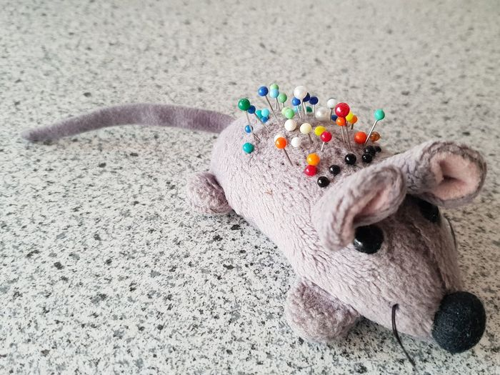 Voodoo-Mouse... Acupuncture Backache Superstition  Stab Black Yellow Green Red Blue White Needling Pin Pinheads Right Mouse Ears Marketing Sales Person Animal Rat Cuddly Toy Plush Toy Mouse Voodoo Needles Copy Space Grey Zoom Close Up Toy Animal Stuffed Toy