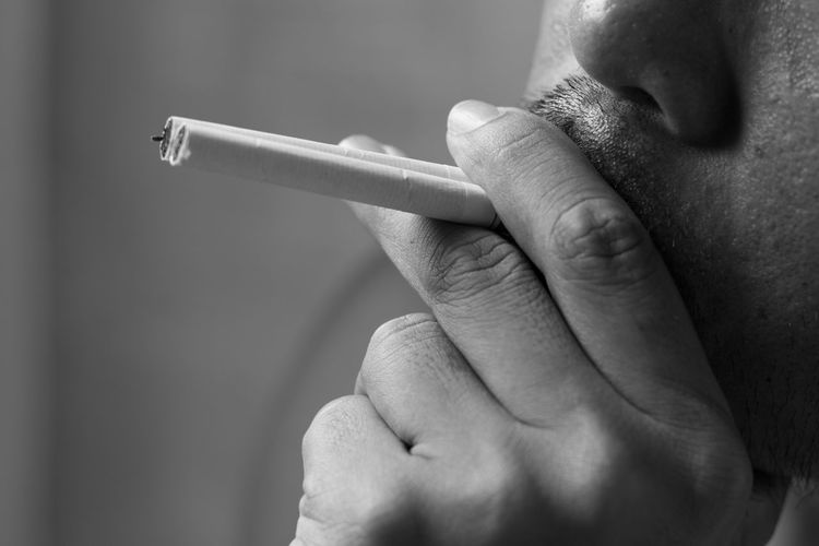 Close-up of man smoking cigarettes
