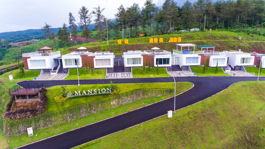 Mansion on high green hills Plant Architecture Grass Tree Built Structure Building Exterior Building House Nature Land No People Green Color Day Landscape Field Outdoors Environment Residential District Sky Hill Luxury Houses Mansion Mansion House Mansions