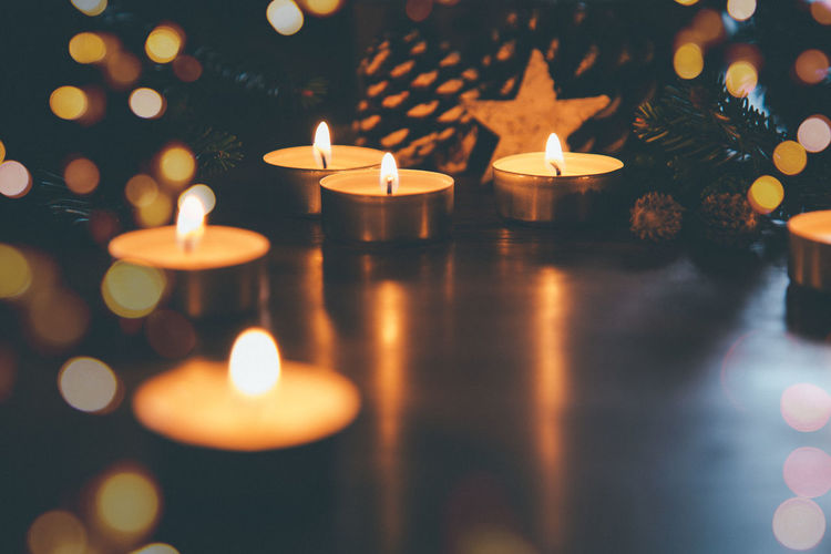 Candle Flame Burning Fire Selective Focus Indoors  No People Decoration Christmas Illuminated Dark Night Film Grain Bokeh Celebration Symbol Candlelight Copy Space First Eyeem Photo Pine Cone Fir Branch Sky Star Shape Holiday