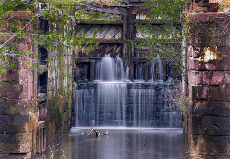 Sluice Gates Gates Architecture Beauty In Nature Blurred Motion Day Flowing Flowing Water Forest Land Leaking Water Lock Gates Long Exposure Motion Nature No People Outdoors Plant Power In Nature Rainforest Scenics - Nature Sluice Gates Splashing Tree Water Waterfall