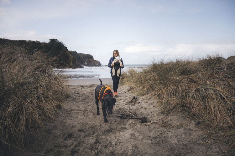 Full length of man with dog standing on land